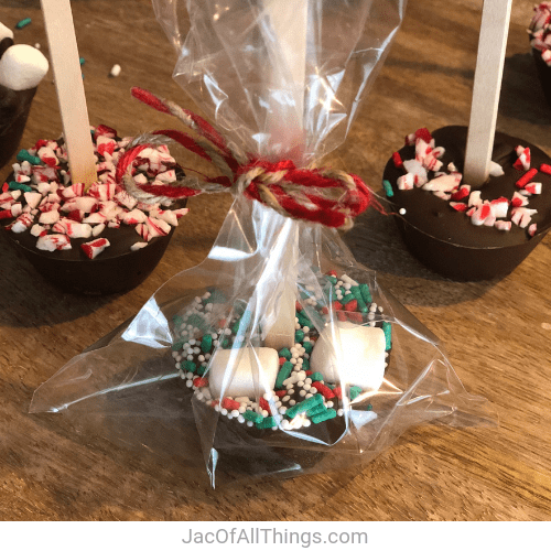 Place hot chocolate stick in a clear treat bag and decorate with a ribbon.